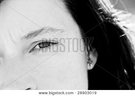 Portrait of woman with awe reflection in her eye. Black and white toned.
