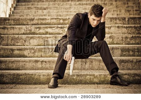 Armed man in stairs