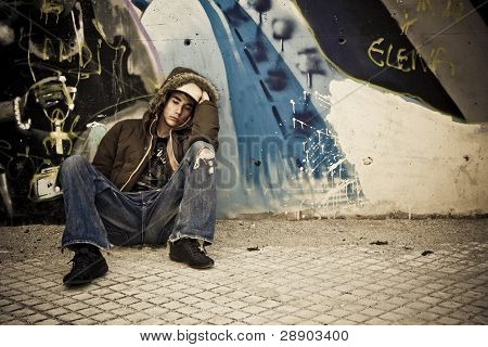 Worried young male on urban background