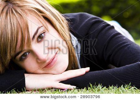 Beautiful woman laying peaceful on the grass