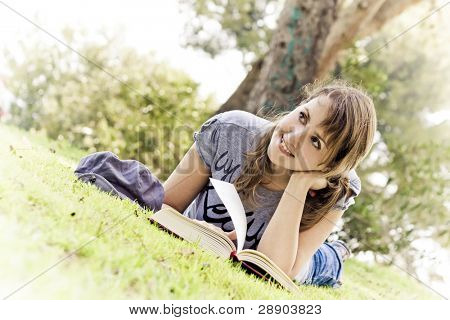 Young woman dreaming with stories and books