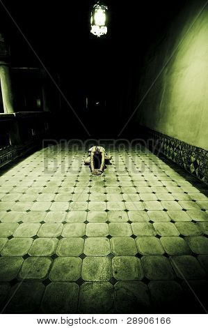 Young woman in white drees on the floor