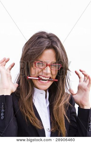 Young businesswoman in red glasses bittin a pen