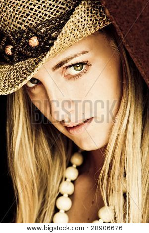 Young blond woman with hat.