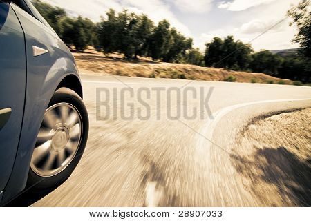 Turning wheel at high speed in the countryside.