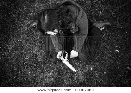 Young sad girl in the floor after killing