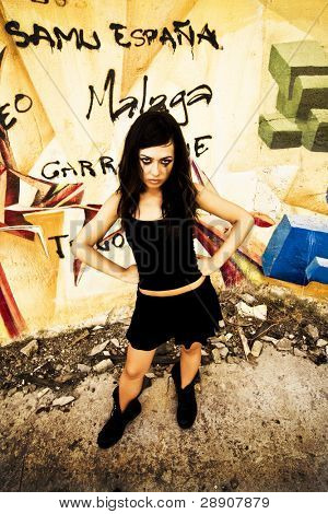 Goth girl posing in urban background.