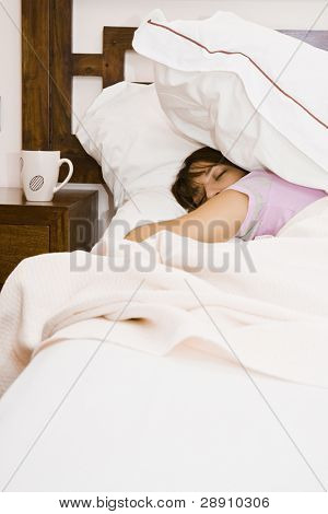 Young sleeping woman near empty cup