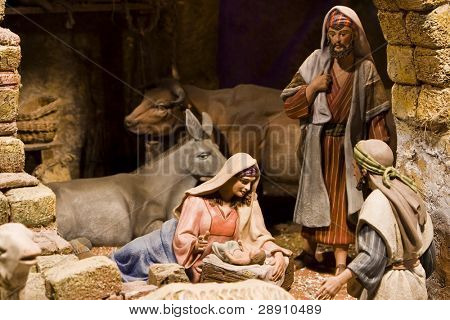 Nativity scene from figurine crib. Focus on Mary and baby Jesus.