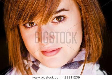 Young woman close portrait staring at camera.