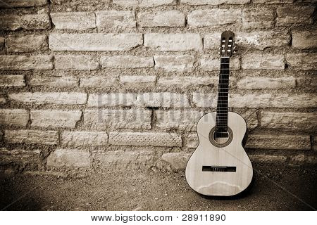 Classic guitar over old brickwall