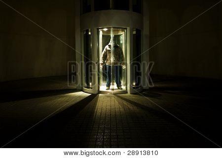 Unrecognizable man looking dangerous, hidden in elevator.