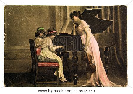woman with a violin and children