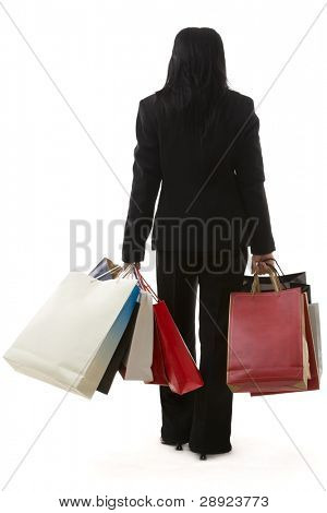 A business woman is carrying a lot of shopping bags, shot from back against white background.