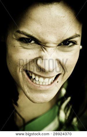 Anger woman close portrait staring at camera