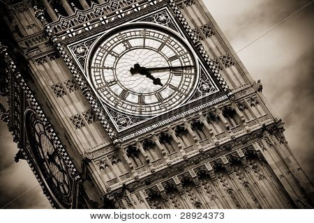 London Big Ben over cloudscape, sepia toned.