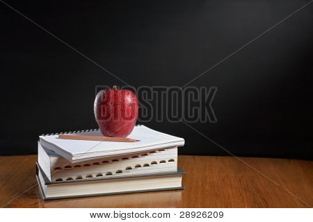 Red apple over pile of books for shool concept