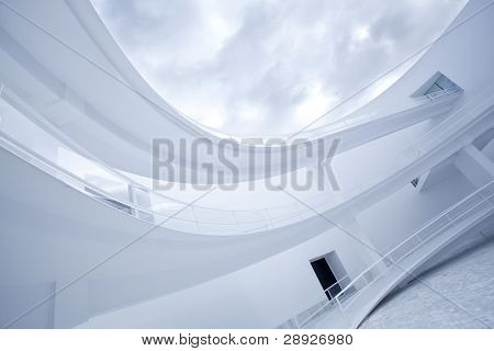 Abstract building exterior under clouded sky