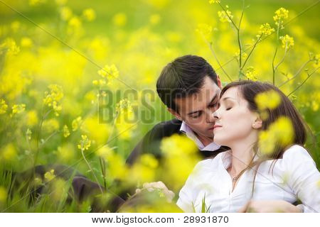 Young beautiful couple loving each other in nature.