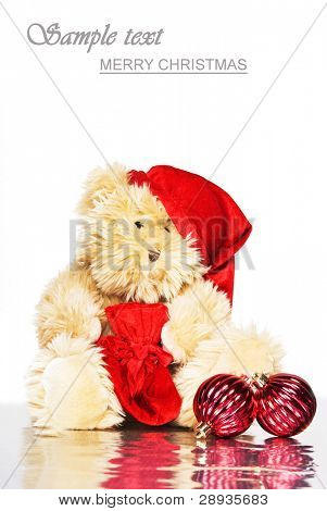 Christmas teddy bear with red christmas balls - space for text