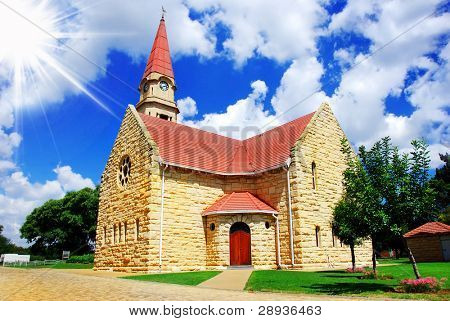 Beautiful old small town church against blue sky