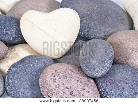 a White heart made of stone on natural colored stones