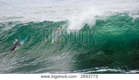 Dive Under Big Surf Wave