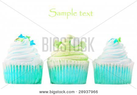 Three blue and white cupcakes on a white background with space for text