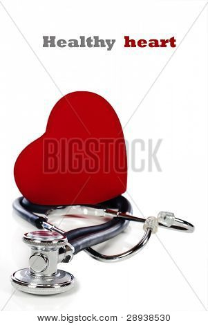 a Healthy heart balanced on a doctor's stethoscope