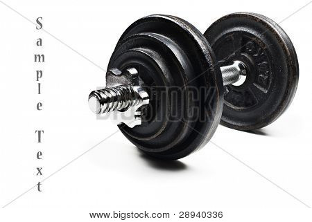 Black and silver dumbbells on a white background with space for text