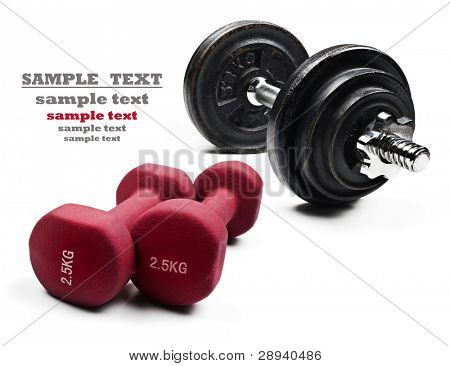 Red and black dumbbells on a pure white background with space for text