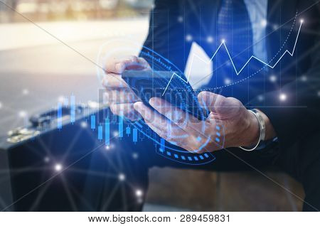 poster of Young Investor Or Business Man Using Mobile Phone With Graphic Global Network Connection And Graph C