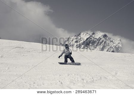 Snowboarder Downhill On Ski Slope