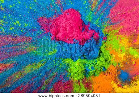 poster of Abstract colorful Happy Holi background. Color vibrant powder on wood. Dust colored splash texture.