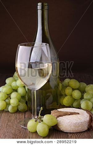 wineglass, bottle, cheese and green grape