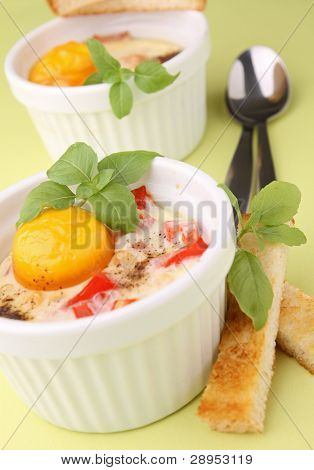 egg cocotte with toast and basil