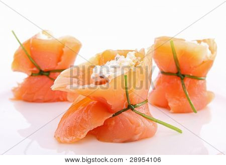 isolated smoked salmon roll with cheese on white background