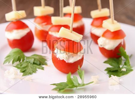 finger food, cherry tomato stuffed with cheese