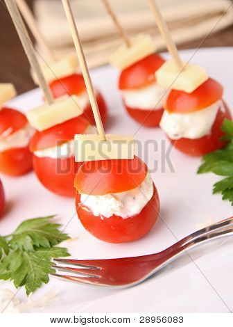 buffet food, cherry tomato with cheese