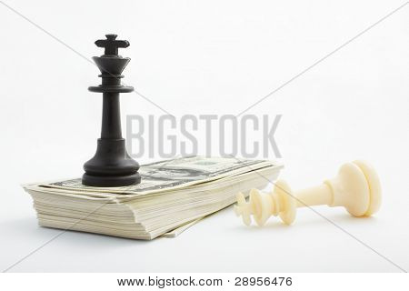 King of chess piece on a stack pf US$100 bills