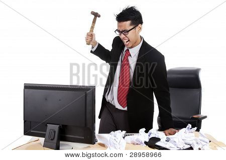 Mad Businessman Hitting His Computer