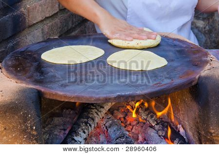 Making flour tortillas. Oven with firewood.