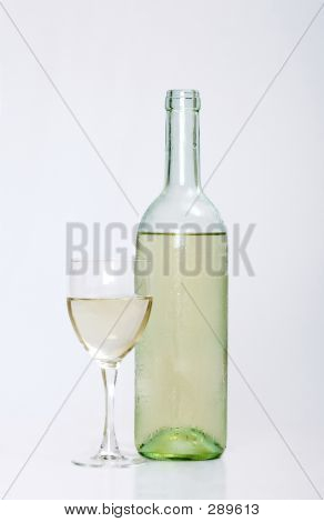 White Wine Bottle With Half Filled Glass