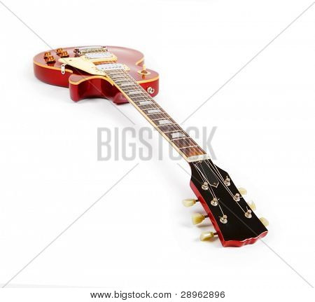 Vintage red electric solid body guitar,Isolated on white. Focus is on nut (0 fret)