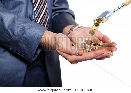 Money Are Threw To Pile Of Coins By Shovel