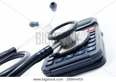 stethoscope on calculator