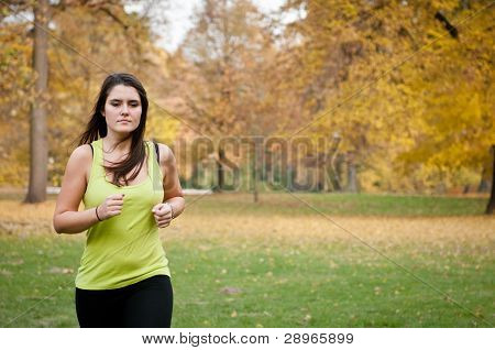 Young Person Jogging Outdoor In Nature