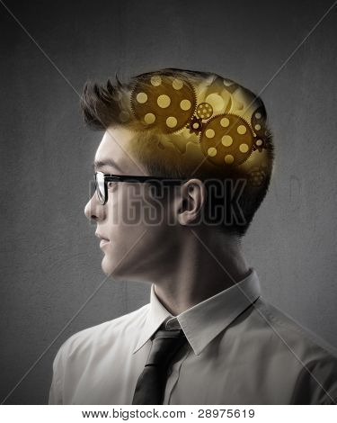 Profile of a young businessman with trundles in his head