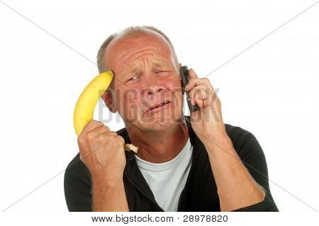 Desperate man pointing his banana gun against his head while phoning