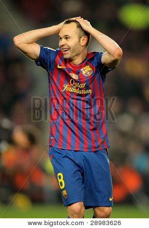 BARCELONA - JAN 15: Andres Iniesta of FC Barcelona reacts during the Spanish league match between FC Barcelona and Real Betis at the Camp Nou stadium on January 15, 2012 in Barcelona, Spain
